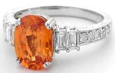 I didn't even know there was such a thing as orange sapphire! Just wish it was a square cut!    Orange Sapphire Ring