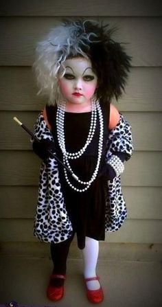 Cruella Deville Halloween Costume for a kid! Who ever did the hair & make up did awesome!