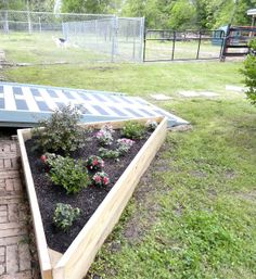 Life as we know it ...: Raised beds anyway . . . An interesting way to construct a triangular bed.