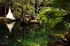 Reflections in beauty. Beautiful bride in her cenote trash the dress shoot in the Riviera Maya.   Riviera Maya photographers Del Sol Photography
