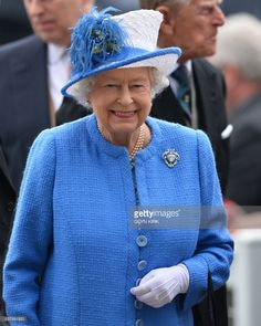 Britain's Queen Elizabeth II and Prince Philip, Duke of Edinburgh arrive for the second day of the Epsom Derby Festival in Surrey, southern England, on June 4, 2016.  / AFP PHOTO / GLYN KIRK        (Photo credit should read GLYN KIRK/AFP/Getty Images)