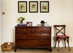 Antique chest of drawers with beautiful brass drop handles.  Love the set of botanical prints in the antiqued black and gold frames. Walls painted in Farrow & Ball Pointing