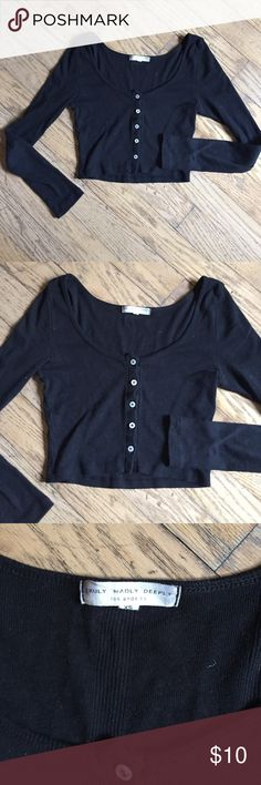 Black Cotton Button Up Crop Top Perfect under a jumper, with shorts or paired with a skirt. Worn a few times and recently washed. Priced according to condition. Urban Outfitters Tops Crop Tops