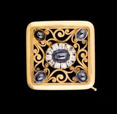 FABERGÉ~ A gold and sapphire brooch by Fabergé, St. Petersburg, workmaster August Frederick Hollowing, late 19th century. Square, centering a sapphire cabochon surrounded by a circle with old-cut and rose-cut diamonds