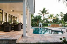 An existing integrated spa that looked dated was eliminated from the pool off the lanai, to allow more space for the walkway.