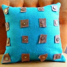 Cushion cover using leather scraps and coins.