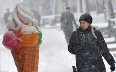 A woman looks at a large ice-cream advertisement during an unexpected heavy snow fall in Kiev, Ukraine Looking For Women, Winter Wonderland, Cool Pictures, Winter Jackets, Kiev Ukraine, Scream, Ice Cream, Snow, Plastic
