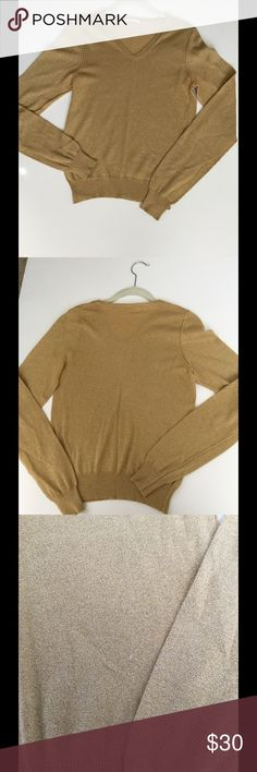 Gold V-Neck Sweater Beautiful gold v-neck sweater. Perfect for holiday events. Has small pilling that I show in third picture. Otherwise, slight pilling overall. 71% cotton, 19% rayon, 10% polyester. Machine washable. Just In Case Sweaters V-Necks