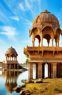 Artistically carved temples around Gadi Sagar (Gadisar) Lake, one of the most important tourist attractions in Jaisalmer, Rajasthan, North India. | 20+ Amazing Photos of India, a Fascinating Travel Destination