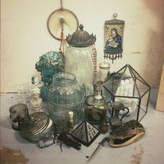 Odd collection of curiosities, glass, religious relics, trinkets.