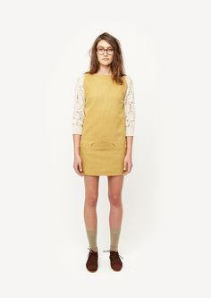 something about her hair + glasses + that dress combo does it for me. ++ arabella ramsay fall 2012 . via calivintage