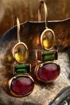 combination of garnets, tourmalines and golden topaz