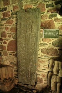 ancient grave slabs of Scottish chieftains which had been moved in here from the graveyard to preserve them.