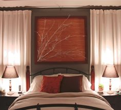 dark bed fram -- gray walls with accent of red\oragne\rust\cream .. and white curtains .