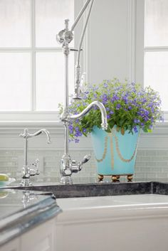 WOWZA!!!  What a faucet!  I'd love to know where to find this, it's beautiful!!