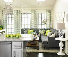 Chevron & Geometrics...love the gray couch and green accents!