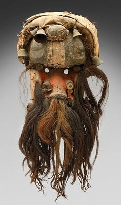 Africa | A mask from the We / Guere people of Liberia / Ivory Coast | Wood, coins, aluminium, bells, natural fiber and pigment