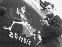 """""""Rear gunner Sgt George Allen completing his artwork on Lancaster B Mk II LL725, """"EQ-Z"""", of 408 Squadron…'Zombie' was lost without trace…on the Hamburg raid of 28 July 1944"""""""