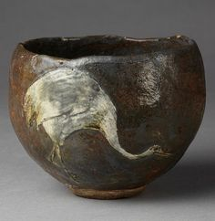 Tea bowl of earthenware, roughly hemispherical with rounded footring. Decorated outside with a crane in white slip, covered with bluish-grey and yellowish glazes, irregularly distributed. Kyoto, Japan, 19th century. V Museum.