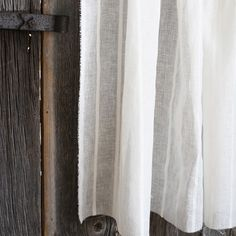 An airy, blended linen sheer fabric in a natural off white with a natural stripe. Perfect for sheers to pair with drapes but also as stand alone curtains with a light lining. Please note this fabric is not suitable for upholstery.Content: 45% Linen / 26% Cotton / 18% Viscose / 11% Polyester Width: 54