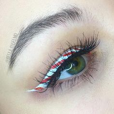 Bella (@bella.anselmo) creates a candy cane inspired christmas makeup look with winged liner made from Illamasqua sealing gel #illamafia