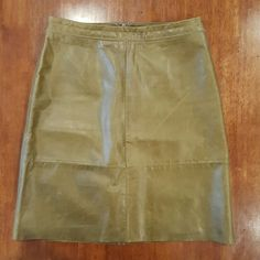 "GAP green leather skirt Chartreuse green/pea green leather pencil skirt. ""Patchwork"" seams and zigzag stitching add subtle detail to skirt. Fully lined.  Hidden back zipper. 20"" long. Excellent condition!! GAP Skirts"