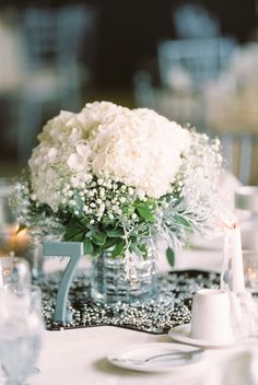 Babys Breath and White Hydrangea Centerpiece | photography by http://www.kristinlavoiephotography.com