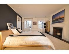 Bedroom with brick fireplace at 9 Chestnut, Boston, MA, 02108