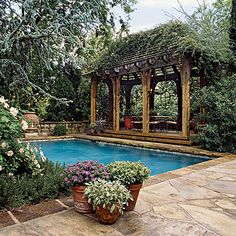 * Lady Banks's roses atop the cabana make it a secluded and shady spot.
