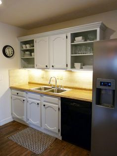 Really considering painting all the cabinets white with stainless steel appliances.