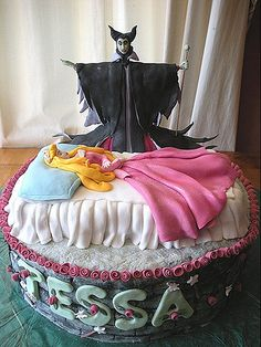 Maleficent and Sleeping Beauty Cake: I'd do this, but I'd have Maleficent creeping over the side or something.