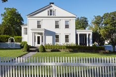 Traditional White Country Colonial With Landscaping And White Picket Fence This charming sea captain's home in Southport, Connecticut features column details, classic landscaping, and white picket fence. Colonial Exterior, House Design Photos, Southport, Home Pictures, City Living, House Numbers, Home Improvement Projects, Hgtv, Curb Appeal