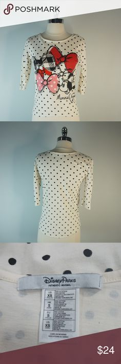 Disney Minnie Mouse Black White Polka Dot Bow  XS Brand: Disney Condition: Preowned Comes from a smoke free and pet free environment, No stairs rips tears etc. Size: XS Background color: Black & White Print: Polka Dot How to put it on: Pullover  Fabric Content: Disney Tops Tees - Short Sleeve