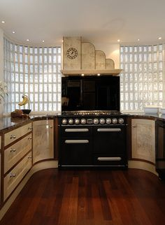 A stunning kitchen with Art Deco flair.  Art Deco Kitchens by Aspect Kitchens, Surrey