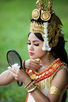 Portrait of an Apsara Dancer | Apsaras are female spirits or celestial nymphs in Hindu and Buddhist mythologies. They're young, beautiful, magical and, not surprisingly, excellent dancers.  Apsara dances tell classical myths inspired by the Cambodian version of the Ramayana and Angkor's golden age (889–1434) when its major temples — Angkor Wat, Bayon and Ta Prohm— were built.  | Image and caption © Julie Hall