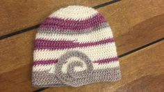 Karin Byom - hat in Oslo stitch with a curl.