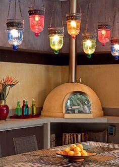 Churrasqueira e forno de pizza em espaços bem planejados - Casa