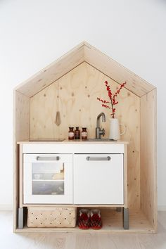 ikea playkitchen in a wooden house