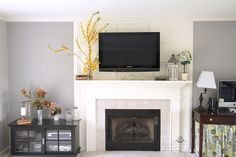 t.v mounted over the fireplace using wood slats as channels for the cords.  no drilling behind the wall.  brilliant!!