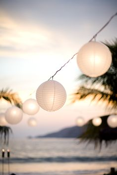 style me pretty - real wedding - mexico - mexico beach wedding - reception decor - lounge area - paper lanterns