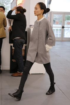 grey jacket, black skinnies & black ankle boots.