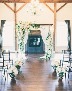 Amazing #wedding ceremony floral decor. Image by Rachel May Photography.