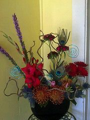 peacock feathers, liatris, gladiolas, sweet william, pincushion, gerbera daisies, sea holly, salal, corylus branches, godetia, green ball dianthus, wire curls