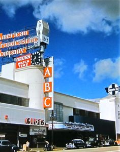 This wonderful color shot from 1952 is of the American Broadcast Company (ABC, aka radio station KECA) on Vine Street in Hollywood, a little south of the Hollywood and Vine corner. On the far right we can see the sign for the Santa Fe railway company.