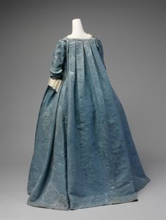 This robe volante is an exceedingly rare example of a well-documented form of dress that marked the transition from the mantua of the late seventeenth and early eighteenth centuries to the robe à la française, the dress style that became ubiquitous in the eighteenth century