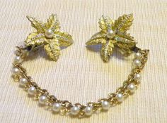 Vintage Sweater Guard  Clips Star Flower Auroura Boarealis Faux Pearl Gold Grips. $28.00, via Etsy.