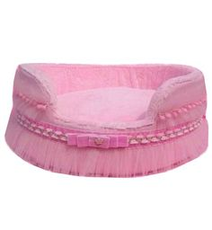 Pamper Me Pink Pet Bed Luxury bed with pink tulle with bow and ribbon witch wraps around the bed. Soft velvet lining. corduroy outer, pink tutu and pompom velvet strip with bow at the round and front. Dream princesses bed.