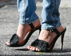 Courtesy of stylist Monica Rose? The 5ft reality star - who turns 37 next month - opted to wear boudoir-style, marabou-covered heels during her errands