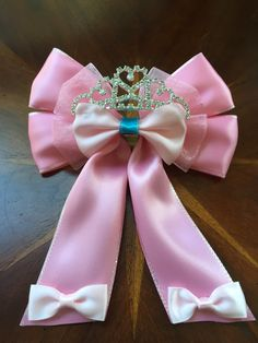 """My """"Pretty, Pretty Princess"""" hair bow.  I had a parent come up with the colors and designs but wanted a fancy crown after seeing the Sharpay Evans bow I made. Another happy bowtiquer!   #hairbow #hairbows #handmade #crafty #sparkles #missmbowtique #missmaeganbowtique #missmaegansbowtique #prettyinpink #prettyprettyprincess #oneofakind"""