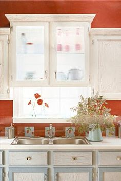 Create storage and still let in light in a small kitchen - The Old House in Texas: Glass-backed kitchen cabinets.